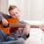 weinig · jongen · spelen · gitaar · home · sofa - stockfoto © Giulio_Fornasar