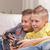 cute · peu · garçon · jouer · jeux · vidéo · famille - photo stock © giulio_fornasar
