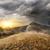 dourado · luz · montanhas · céu · natureza · árvores - foto stock © givaga