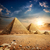 sunset over pyramids stock photo © givaga