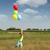 menina · feliz · corrida · prado · colorido · balões · pais - foto stock © goce