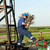 worker with pipe wrench on oilfield pipeline stock photo © goce