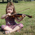 little girl sitting on grass and play violin stock photo © goce