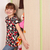 happy little girl trying to close messy closet stock photo © goce