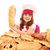 happy little girl cook holding bread stock photo © goce
