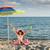 little · girl · seis · sessão · guarda-sol · praia · criança - foto stock © goce