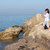 little girl standing on a rock by the sea and playing saxophone stock photo © goce