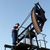 oil worker climb on pump jack stock photo © goce