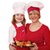 mother and daughter cook with chicken drumstick stock photo © goce