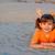 little girl lying on sand stock photo © goce