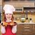 boldog · kislány · szakács · tart · edény · bruschetta - stock fotó © goce
