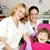 happy little girl patient with dentist and nurse stock photo © goce