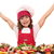 happy little girl cook with prepared salmon seafood stock photo © goce