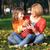 gyerekek · eszik · almák · ősz · park · család - stock fotó © goce