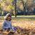 happy beautiful little girl in autumn park stock photo © goce