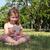 glimlachend · jong · meisje · vergadering · gras · lifestyle - stockfoto © goce