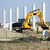 excavator working on new factory construction site stock photo © goce