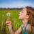 little girl blowing dandelion stock photo © godfer