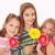 boldog · mosolyog · nővérek · csoport · virágok · gyerekek - stock fotó © godfer