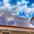 zonnepaneel · Rood · dak · zon · onbewolkt · blauwe · hemel - stockfoto © grafvision