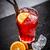 red cocktail with orange slice stock photo © grafvision