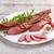 füstölt · fűszeres · disznóhús · vesepecsenye · szeletek · hagyma - stock fotó © grafvision