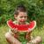 gyermek · eszik · görögdinnye · boldog · nagy · piros - stock fotó © grafvision