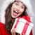 mooie · jonge · vrouw · kerstman · kleding · geschenk · grijs - stockfoto © grafvision