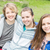 três · meninas · sessão · juntos · grama · verde · mão - foto stock © gregorydean