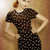 Pin-Up retro girl in classic fashion polka dots dress posing stock fotó © gromovataya