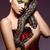 Beautiful Woman holding Python Snake in Hands - Performance stock photo © gromovataya