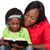матери · чтение · книга · счастливая · семья · детей · сидят - Сток-фото © handmademedia