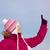 Girl in witer clothes pointing upwards stock photo © Harlekino