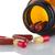 piros · tabletták · tabletta · üveg · fehér · boldog - stock fotó © homydesign