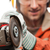 engineer or manual worker man in safety hardhat helmet holding a stock photo © ia_64