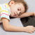 tired sleeping child boy holding tablet computer stock photo © ia_64