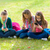 teen girls on grass using their mobile phones stock photo © icefront