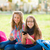 teen schoolgirls having fun with mobile phone stock photo © icefront