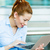Woman working on computer, browsing internet stock photo © ichiosea