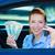 woman holding car keys dollar bills sitting in her new car stock photo © ichiosea