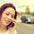 portrait of a young woman talking on mobile phone outdoors stock photo © ichiosea