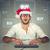 christmas man in santa hat buying stuff online holiday shopping stock photo © ichiosea