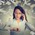 businesswoman looking at wrist watch talking on mobile phone under cash rain stock photo © ichiosea