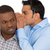 guy whispering something annoying into man's ears stock photo © ichiosea