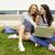 młoda · kobieta · za · pomocą · laptopa · kampus · trawnik · inny · studentów - zdjęcia stock © iko