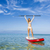 a beautiful and happy woman with arms up and learning paddle surf stock photo © iko