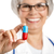 female doctor holding a pill stock photo © iko