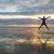 силуэта · человека · оружия · пляж · закат · счастливым - Сток-фото © iko
