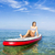 Woman sitting over a paddle surfboard stock photo © iko