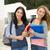 dos · hermosa · estudiantes · caminando · sonriendo - foto stock © iko